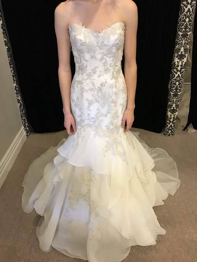 Preload https://img-static.tradesy.com/item/22601920/sottero-and-midgley-ivory-organza-lace-maky-modern-wedding-dress-size-10-m-0-1-540-540.jpg
