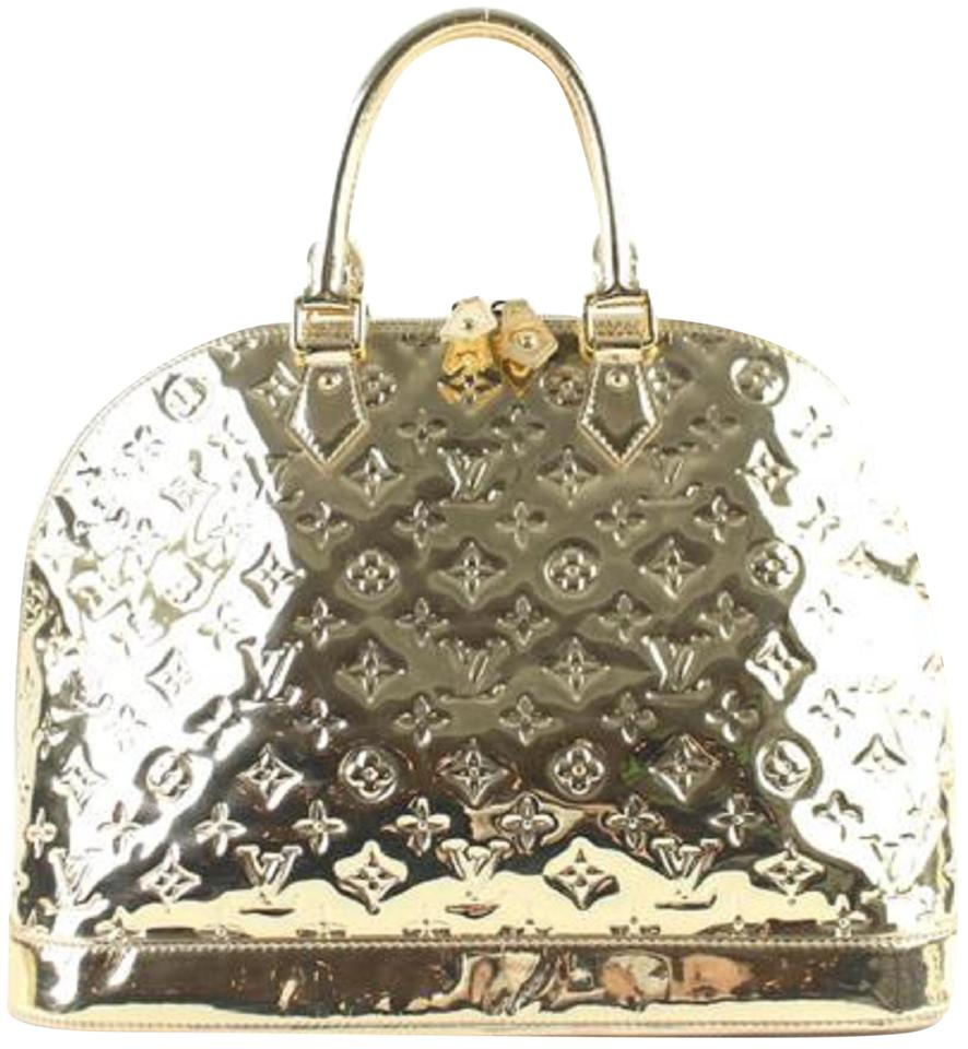 Louis vuitton gold vinyl miroir alma mm satchel tradesy for Louis vuitton silver alma miroir