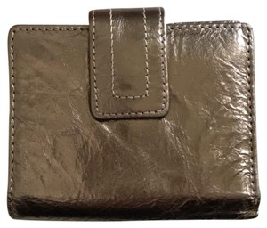 Fossil Wristlet in metallic bronze