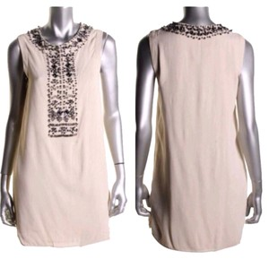 Renzo and Kai short dress Beige on Tradesy