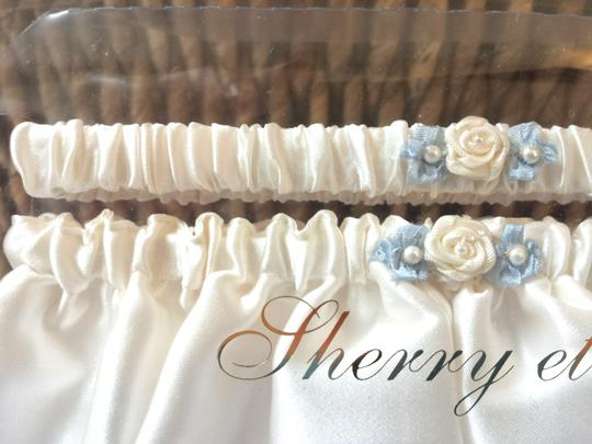 Ivory with Light Blue Leg Garter Sashes