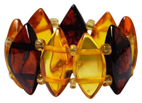 Preload https://img-static.tradesy.com/item/22626405/ny-collection-brown-womens-natural-multicolored-amber-gemstone-adjustable-band-ring-0-1-540-540.jpg