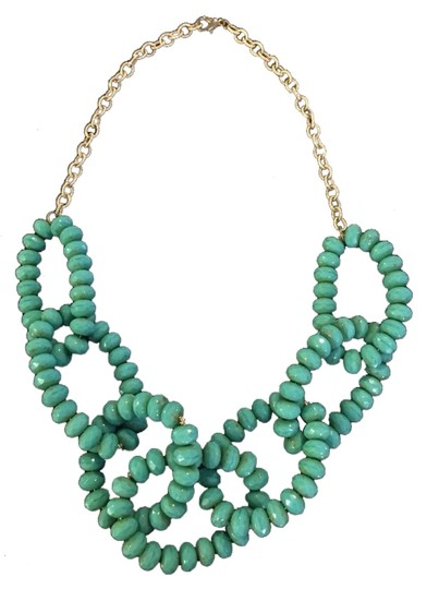 Preload https://item2.tradesy.com/images/turquoise-and-gold-beaded-statement-necklace-2262926-0-0.jpg?width=440&height=440