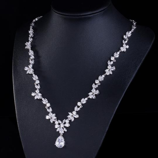 Preload https://item2.tradesy.com/images/other-18-karat-white-gold-cubic-zirconia-flower-necklace-set-2263701-0-1.jpg?width=440&height=440
