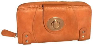 Charming Charlie Gold accented locking wallet