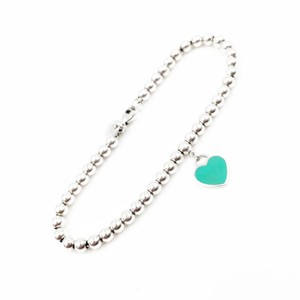 Tiffany & Co. Brand New Mini Return Blue Heart Beads 10k2334 Bracelets