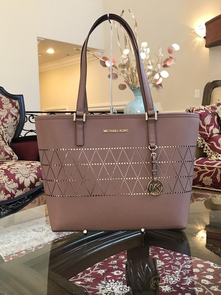 84207cd5123e Michael Kors Mk Carryall Saffiano Leather Travel Carryall Tote in dusty rose  Image 9. 12345678910
