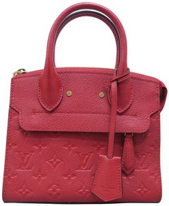 Louis Vuitton Lv Monogram Empreinte Calfskin Leather Tote in red