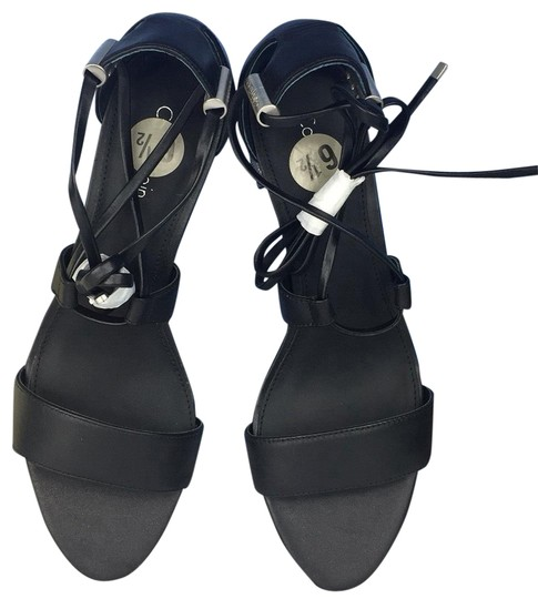 Preload https://img-static.tradesy.com/item/22649454/calvin-klein-black-new-leather-women-s-sandal-pumps-size-us-85-regular-m-b-0-1-540-540.jpg