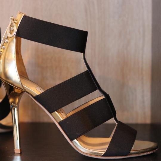 Jimmy Choo black and gold Pumps