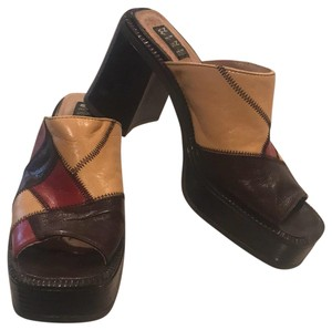 Nine West multi-colored Mules