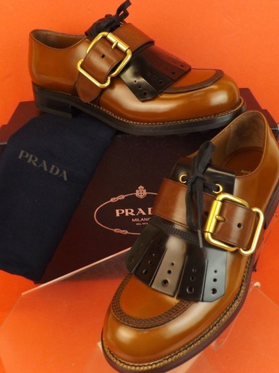 Preload https://img-static.tradesy.com/item/22650356/prada-tobaccoblack-leather-removable-fringe-buckle-dress-oxfords-65-us-75-shoes-0-0-540-540.jpg