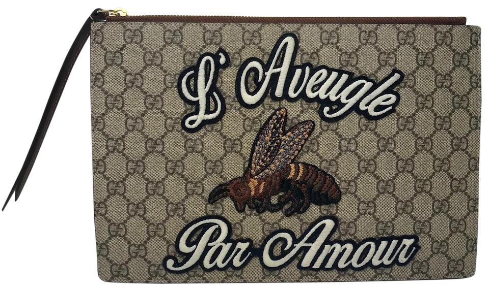 5d99db18d10cdb Gucci Embroidered Gg Supreme Pouch Beige/ Ebony Canvas Clutch - Tradesy