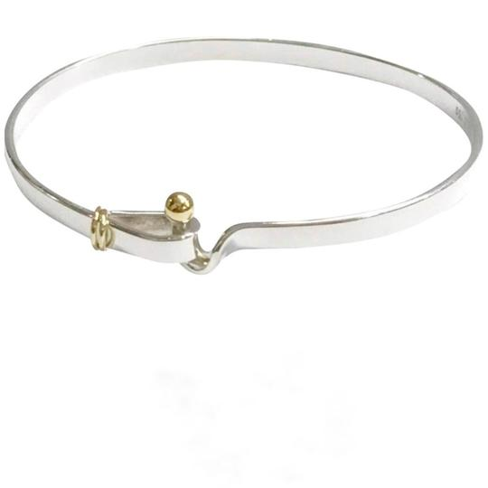 Preload https://item5.tradesy.com/images/tiffany-and-co-18-karat-yellow-gold-and-sterling-silver-hook-and-eye-bangle-bracelet-22655619-0-0.jpg?width=440&height=440