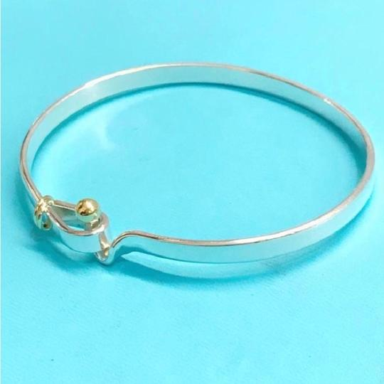 Tiffany & Co. BEAUTIFUL!! Tiffany & Co. 18 Karat Yellow Gold and Sterling Silver Hook and Eye Bangle Bracelet