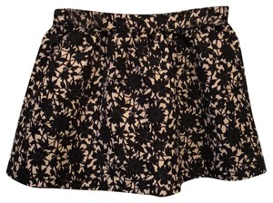 Frenchi Mini Skirt Black on cream all-over floral vine print.