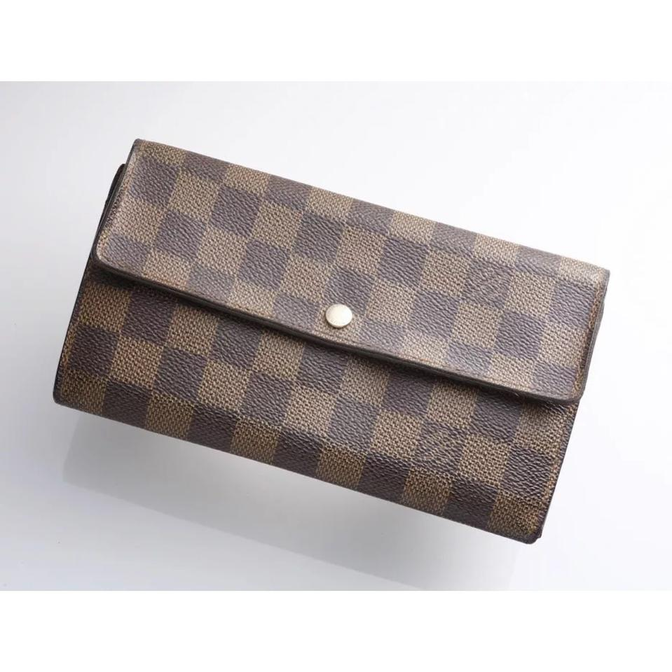 69e628617b09d Louis Vuitton Damier Ebene Sarah long wallet Image 0 ...
