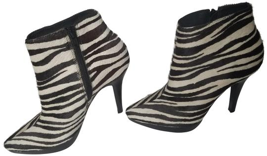 Preload https://img-static.tradesy.com/item/22676878/steve-madden-black-white-zebra-stripes-animal-print-stiletto-platform-7m-bootsbooties-size-us-7-regu-0-1-540-540.jpg