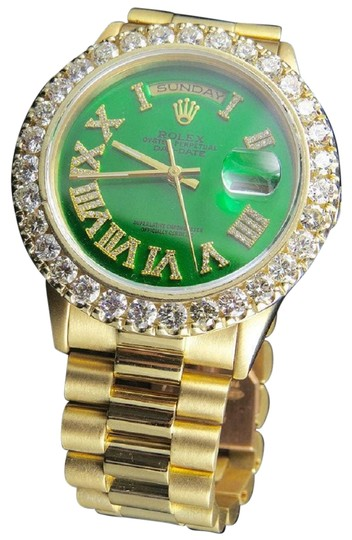 Preload https://img-static.tradesy.com/item/22676893/rolex-yellow-gold-18k-green-dial-president-day-date-18038-36mm-diamond-65-ct-watch-0-1-540-540.jpg