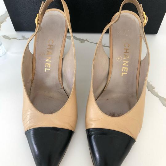 Chanel Creme and navy blue Pumps