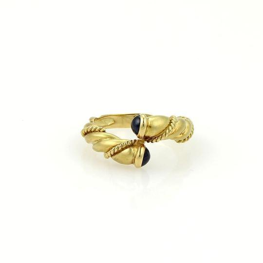 Preload https://img-static.tradesy.com/item/22677995/tiffany-and-co-yellow-gold-sapphire-twisted-design-bypass-band-ring-0-0-540-540.jpg