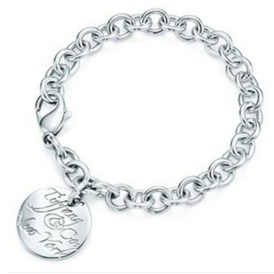 Preload https://img-static.tradesy.com/item/22679892/tiffany-and-co-retired-notes-round-tag-link-bracelet-0-8-540-540.jpg