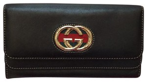Gucci Black leather expandable fold over wallet