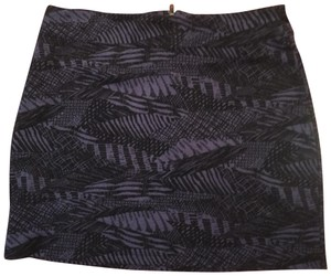 Urban Outfitters Mini Skirt Plum with black pattern.