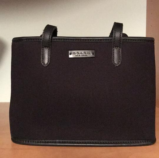 Preload https://item3.tradesy.com/images/coach-classic-black-soft-material-tote-22687167-0-0.jpg?width=440&height=440