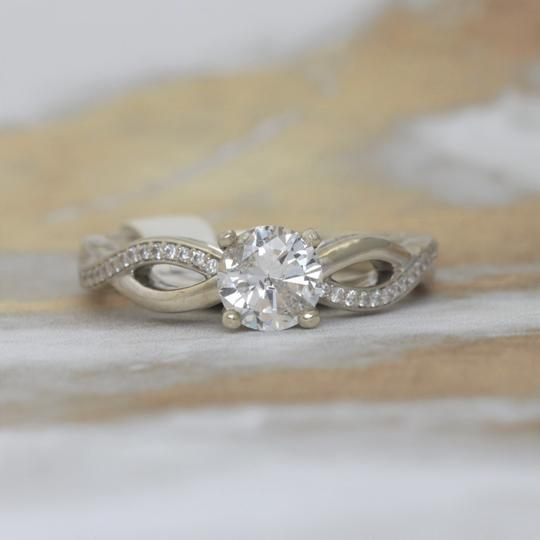 Preload https://item4.tradesy.com/images/white-gold-twisted-solitaire-diamond-14k-engagement-ring-22687423-0-0.jpg?width=440&height=440