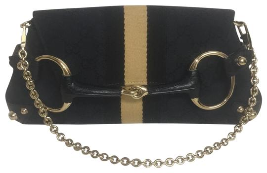 Preload https://item4.tradesy.com/images/gucci-gg-gold-chain-and-studs-black-canvas-logo-with-leather-trim-shoulder-bag-22687993-0-1.jpg?width=440&height=440