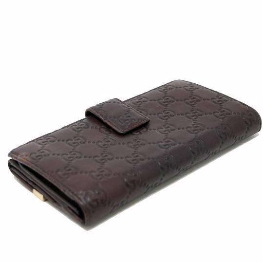 Gucci Signature Guccissima GG Continental Brown Dice Leather Wallet