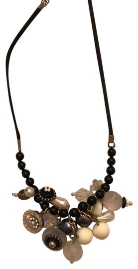 Preload https://item4.tradesy.com/images/vintage-look-multibead-black-leather-cord-necklace-22688113-0-1.jpg?width=440&height=440