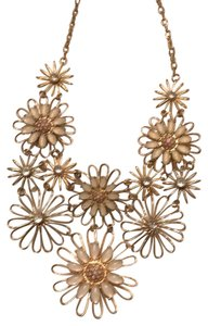 Unknown gold color metal necklace with vintage look floral motif. cream,pink,and clear beading.