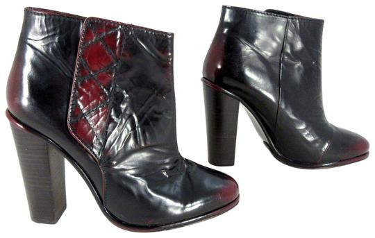 Preload https://item2.tradesy.com/images/opening-ceremony-black-red-oxblood-leather-platform-heeled-ankle-new-bootsbooties-size-eu-38-approx--22688361-0-1.jpg?width=440&height=440