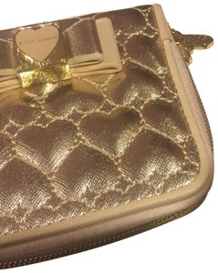 Betseyville by Betsey Johnson Wristlet in Gold & Beige
