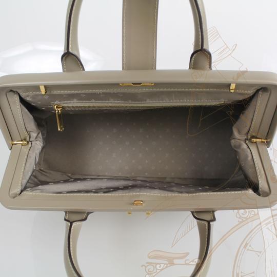 Louis Vuitton Lv Leather Snap Closure Tote in Taupe