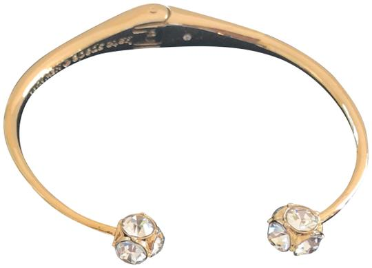 Preload https://img-static.tradesy.com/item/22697947/kate-spade-gold-tone-clear-new-york-lady-marmalade-bangle-bracelet-0-2-540-540.jpg