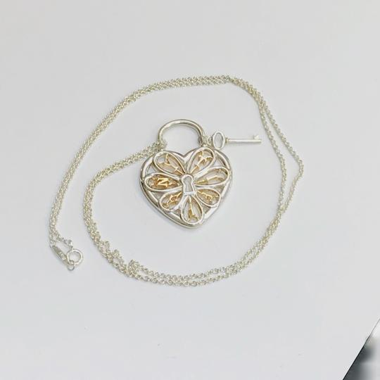 Tiffany & Co. Tiffany & Co. Silver and Rose Gold Large Filigree Heart Key Necklace Image 1