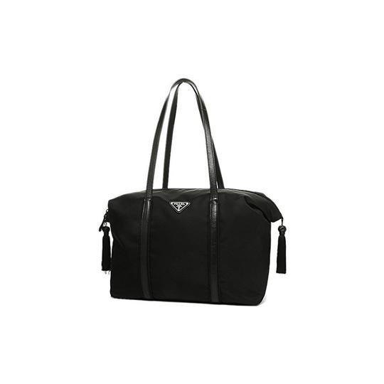 Preload https://img-static.tradesy.com/item/22704258/prada-and-leather-tassel-duffle-1bg135-black-nylon-shoulder-bag-0-0-540-540.jpg