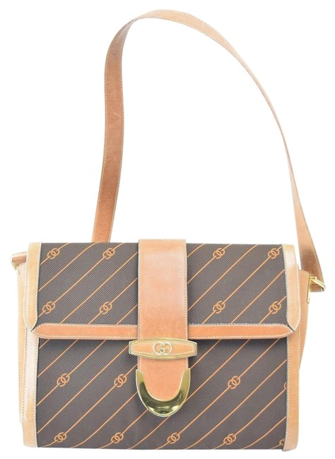 Gucci Vintage Purses/Designer Purses Shades Of Brown with Diagonal Rust Logo Print Leather/Canvas Shoulder Bag Gucci Vintage Purses/Designer Purses Shades Of Brown with Diagonal Rust Logo Print Leather/Canvas Shoulder Bag Image 1