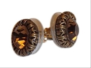 Amber colored stud earrings with bronze colored trim. Costume Jewelery