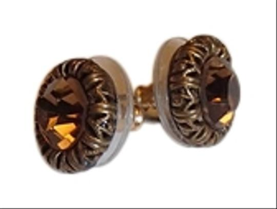 Other Amber colored stud earrings with bronze colored trim. Costume Jewelery