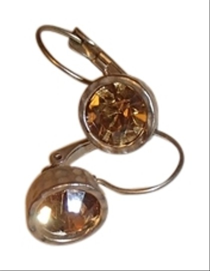 Preload https://item4.tradesy.com/images/unknown-sparkly-amber-drop-earrings-with-bronzegold-trim-costume-jewelry-2270588-0-0.jpg?width=440&height=440