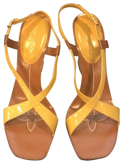 Preload https://img-static.tradesy.com/item/22706654/louis-vuitton-ochre-and-white-lv-patent-leather-wedges-size-eu-395-approx-us-95-regular-m-b-0-1-540-540.jpg