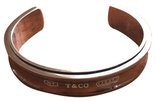 Preload https://img-static.tradesy.com/item/22707010/tiffany-and-co-1837-silver-and-titanium-cuff-bangle-stamped-1997-925-bracelet-0-1-540-540.jpg