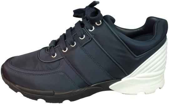 Preload https://img-static.tradesy.com/item/22712522/chanel-navy-blue-sneakers-white-leather-nylon-trainers-lace-up-tennis-new-sneakers-size-eu-395-appro-0-1-540-540.jpg