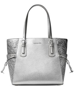 a815d6108d9c Added to Shopping Bag. Michael Kors Leather Voyager Leather Silver Tote in Light  Pewter. Michael Kors Voyager East West Light Pewter Saffiano ...