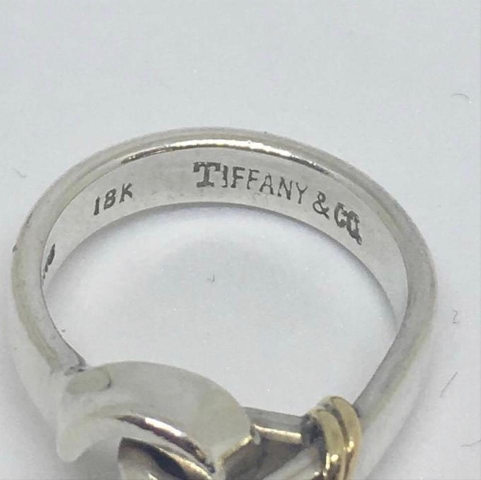 1ac7ba557 Tiffany & Co. 18 Karat Yellow Gold and Sterling Silver Hook. 1234567891011
