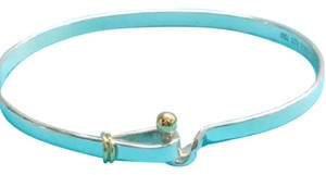Tiffany & Co. Tiffany & Co. 18 Karat Yellow Gold and Sterling Silver Hook and Eye Bangle Bracelet
